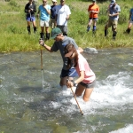 Anna Bawtinhimer and Mack Herman learning to cross a river