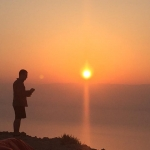Quinn enjoys the sunrise in Israel while completing a summer internship with Operation Groundswell.