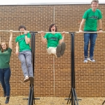 Gabriella, Alex, Esteban and Matt hang out on some of the equipment they constructed for their calisthenics course at UNC Charlotte.