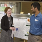 Elizabeth discusses her research poster at UNC Charlotte's Undergraduate Research Conference.