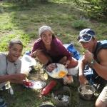 Sam McClenney, Celia Karp and Evan Danchenka making pizza in the backcountry