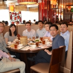 James Parkhill (center) enjoys lunch with his colleagues at Prime Consulting Engineers in Hong Kong.