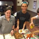 Jenny Jessen, Chris McKinnis and Lawrence Lardieri prepare a dish at Ronald McDonald House.