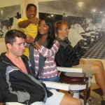 Quinn Barnette, Erica Cherian, Randy Staples and Kyle Henson experience history at the Levine Museum of the New South.