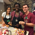 Leila, Chiamaka and Dmitry help prepare a meal for the guests at Ronald McDonald House.