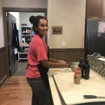 Faith helps prepare a meal for the guests at Ronald McDonald House.