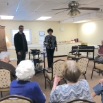 Seth speaks with residents at the Brookdale Senior Living Residence about the nature and bird walk he is creating.