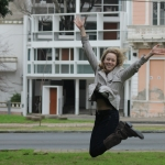 Isabel jumps for joy in Argentina, where she completed an architecture internship.