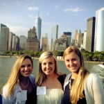 Laura (right) completing Ernst & Young orientation in New York City