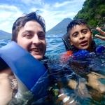 Eddie Angelbello swims with a camper at his YMCA internship.