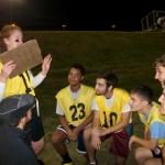 Caitlin Vaverek coaching the Levine Scholars flag football team