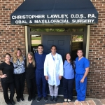 Patrick, center, completed a dental internship in Raleigh, NC.