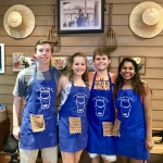 Riley, Lauren, Tyler and Vidhya enjoy a cooking class.